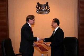 Exchanging MOUs with Zoellick