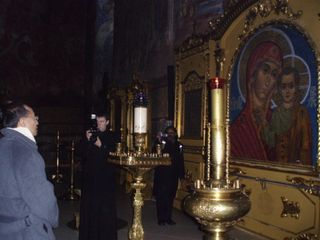 Minister Looking at an Icon of the Virgin Mary