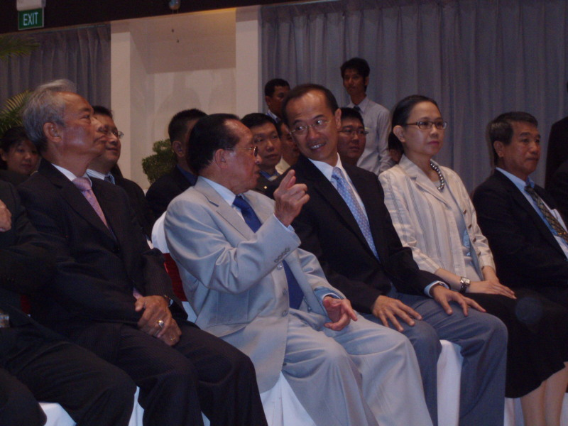 Minister talking to Cambodian DPM and FM Hor Namhong