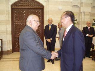 PM Mohammad Naji Al-Otari greeting Minister