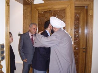 Sheikh Ahmad hugging Minister