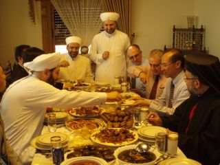 Sheikh Ahmad serving Minister food at lunch