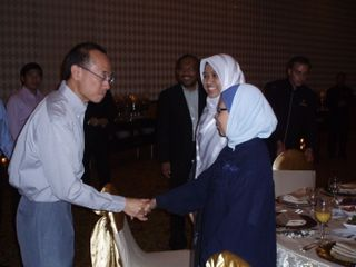 Minister greeting Singaporeans