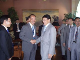 Minister shaking hands with Indonesian FM Hassan