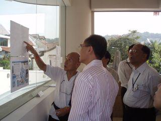 Mr Lee explaining temple's eco-friendly features