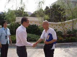 Mr Lee receiving Minister